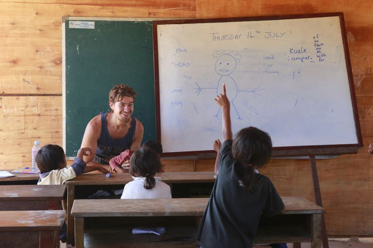 A volunteer teaches English in rural Cambodia
