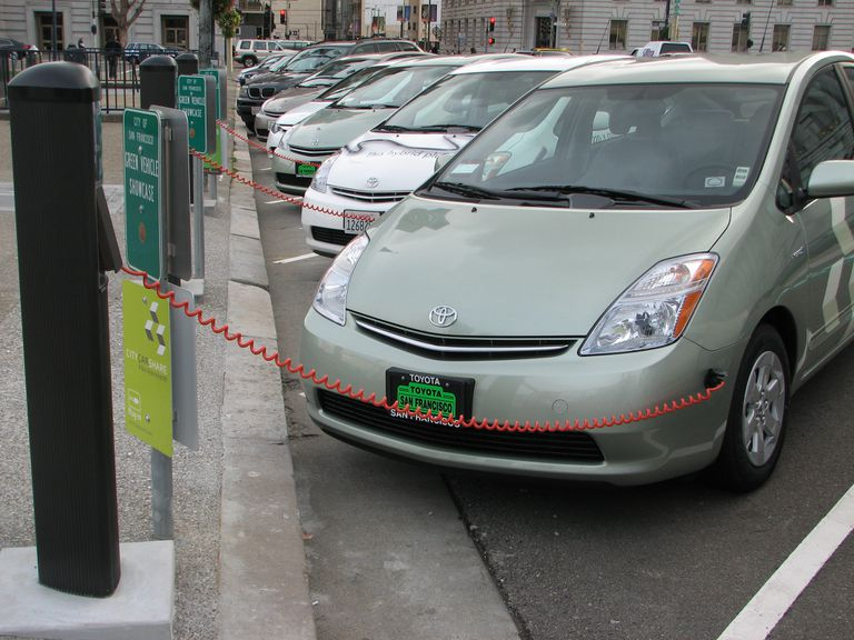 Parked Prius cars plugged in and charging.
