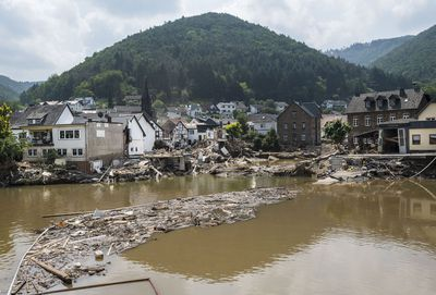 Destroyed houses and the river Ahr pictured one week after the after the devastating flood disaster on July 23, 2021 in Rech, Germany.
