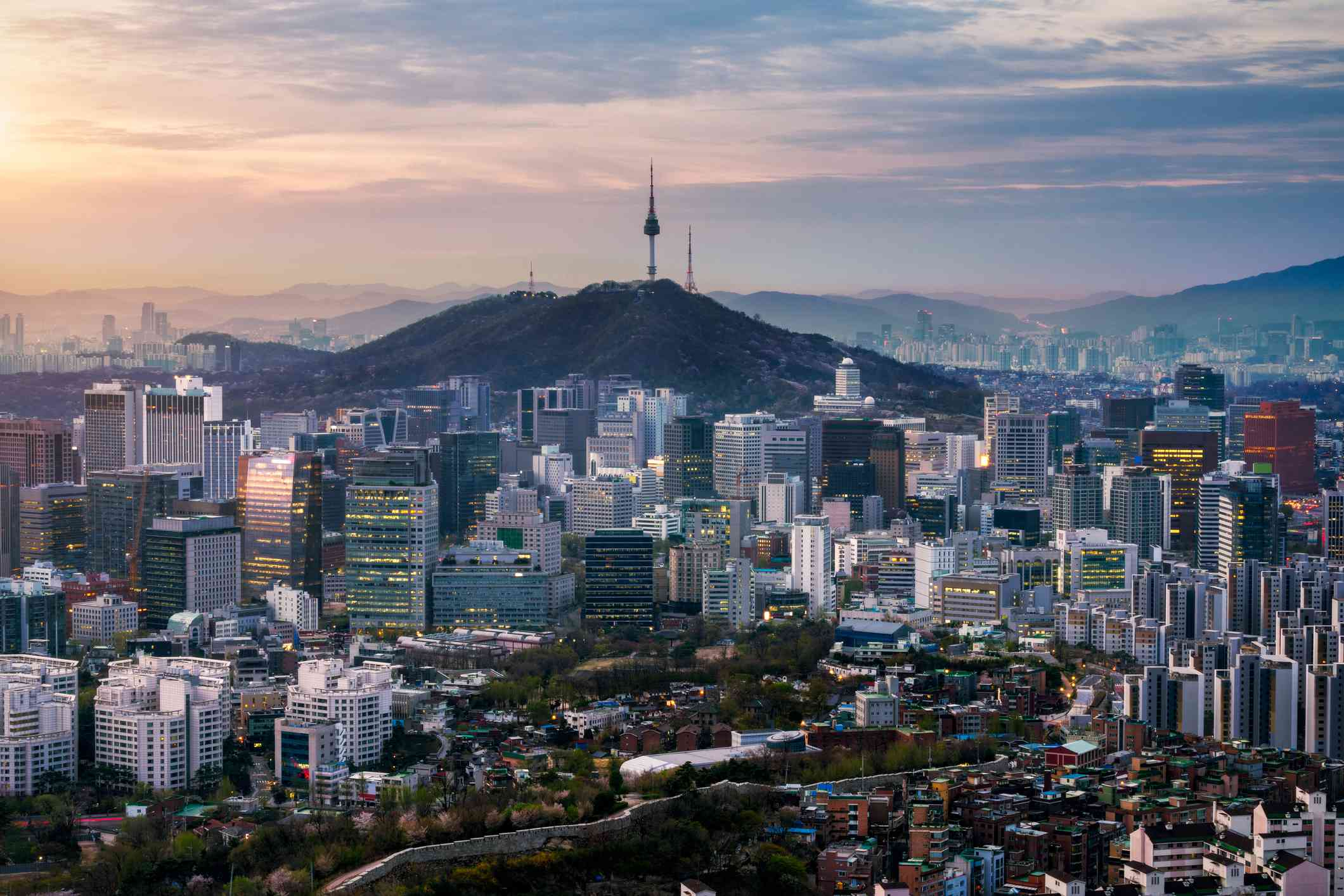aerial view of sunrise over Seoul downtown city skyline, with Seoul Tower at Namsan Park atop Namsan Mountain