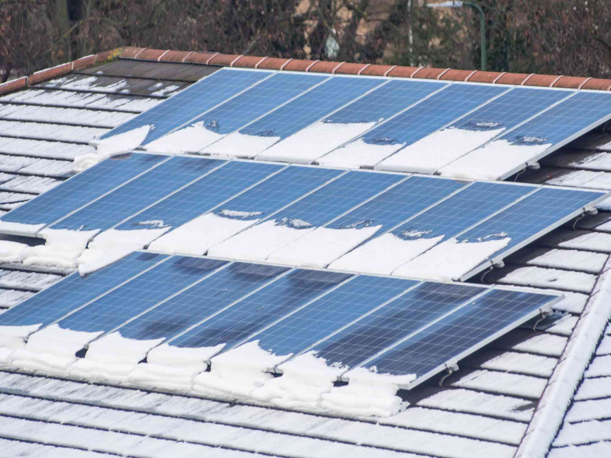 Solar panels on residential roof with snow