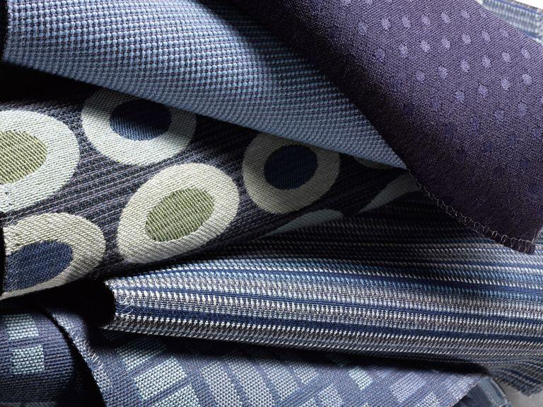 Close up of 5 different textured fabrics