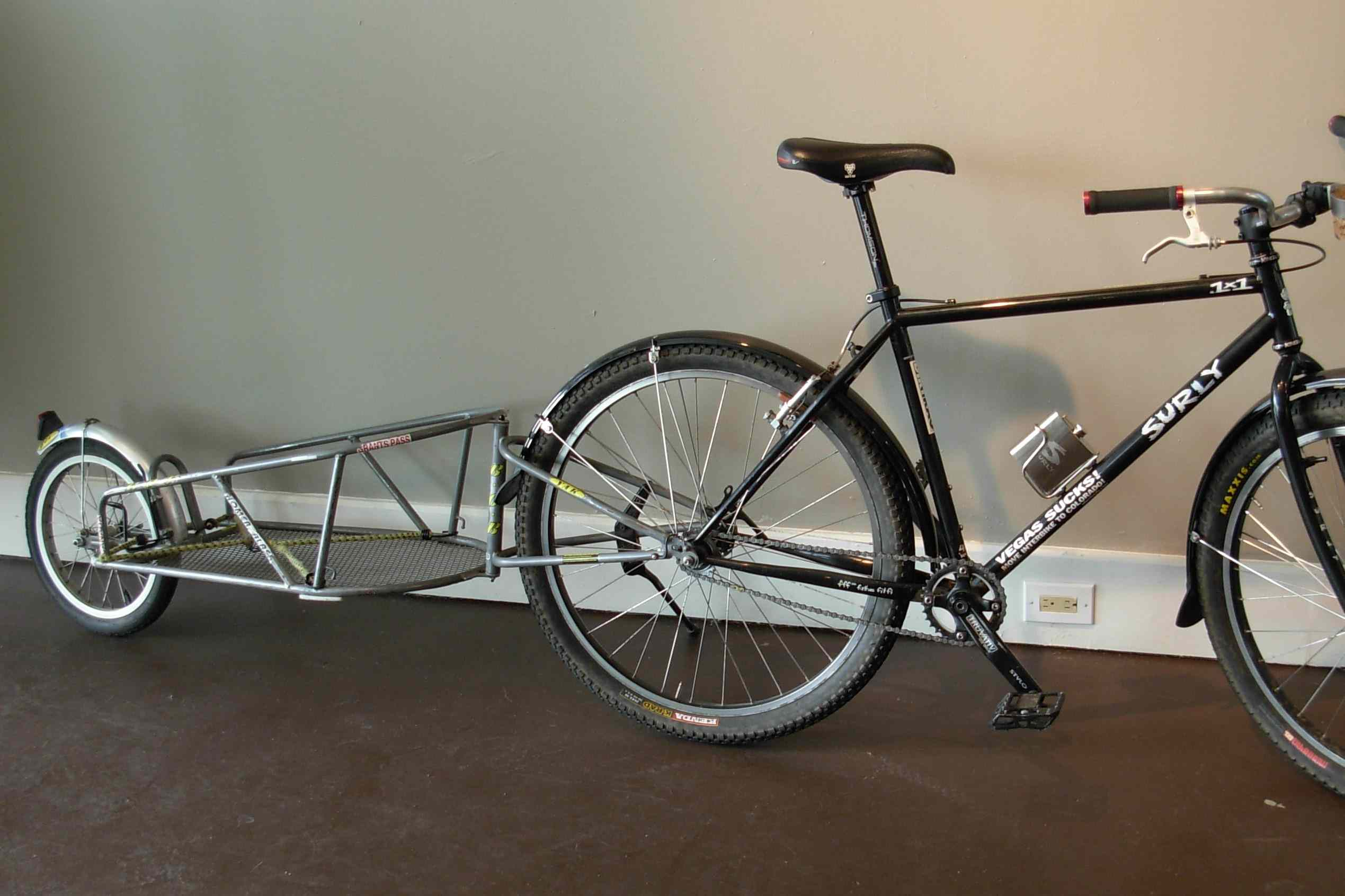 BOB trailer attached to a bike indoors