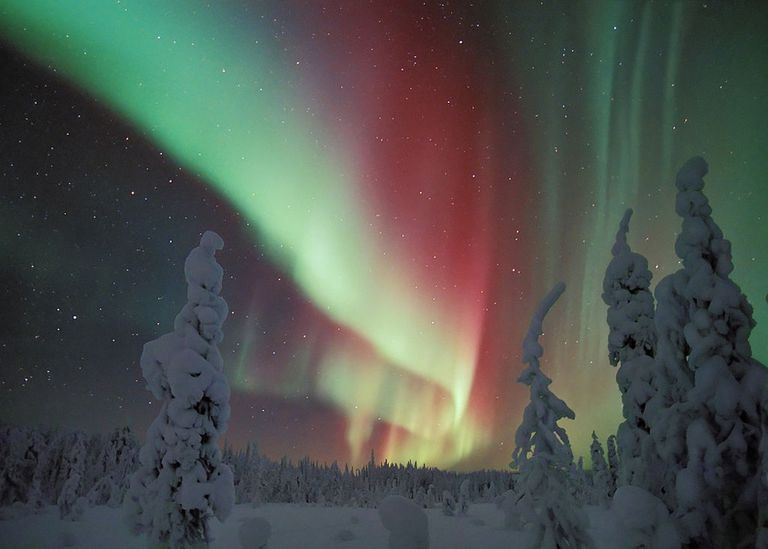The Northern Lights against a snowy landscape
