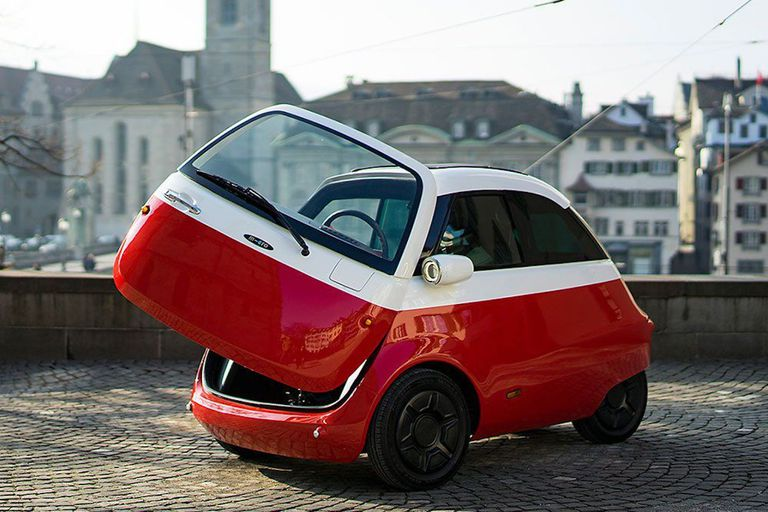 "Red and white ""bubble"" car with door open"