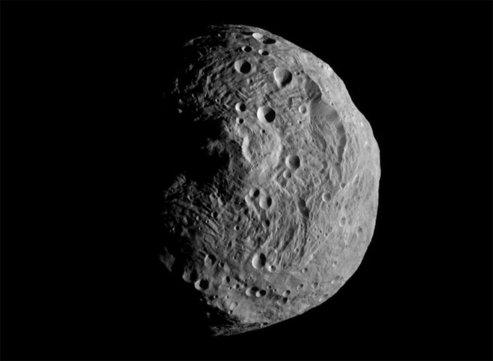 Vesta, as captured by NASA's Dawn spacecraft in 2011, features a mountain that rises more than 65,000 feet above the asteroid's south pole.