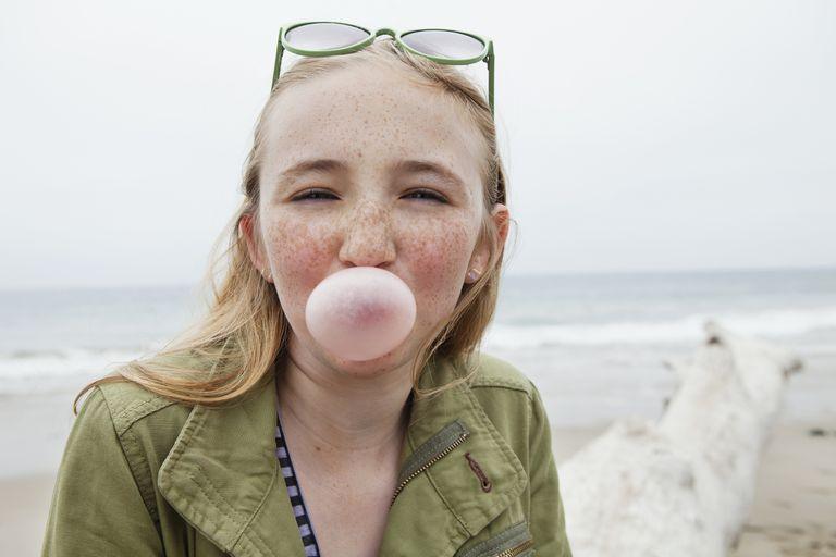 blonde girl blowing bubble gum