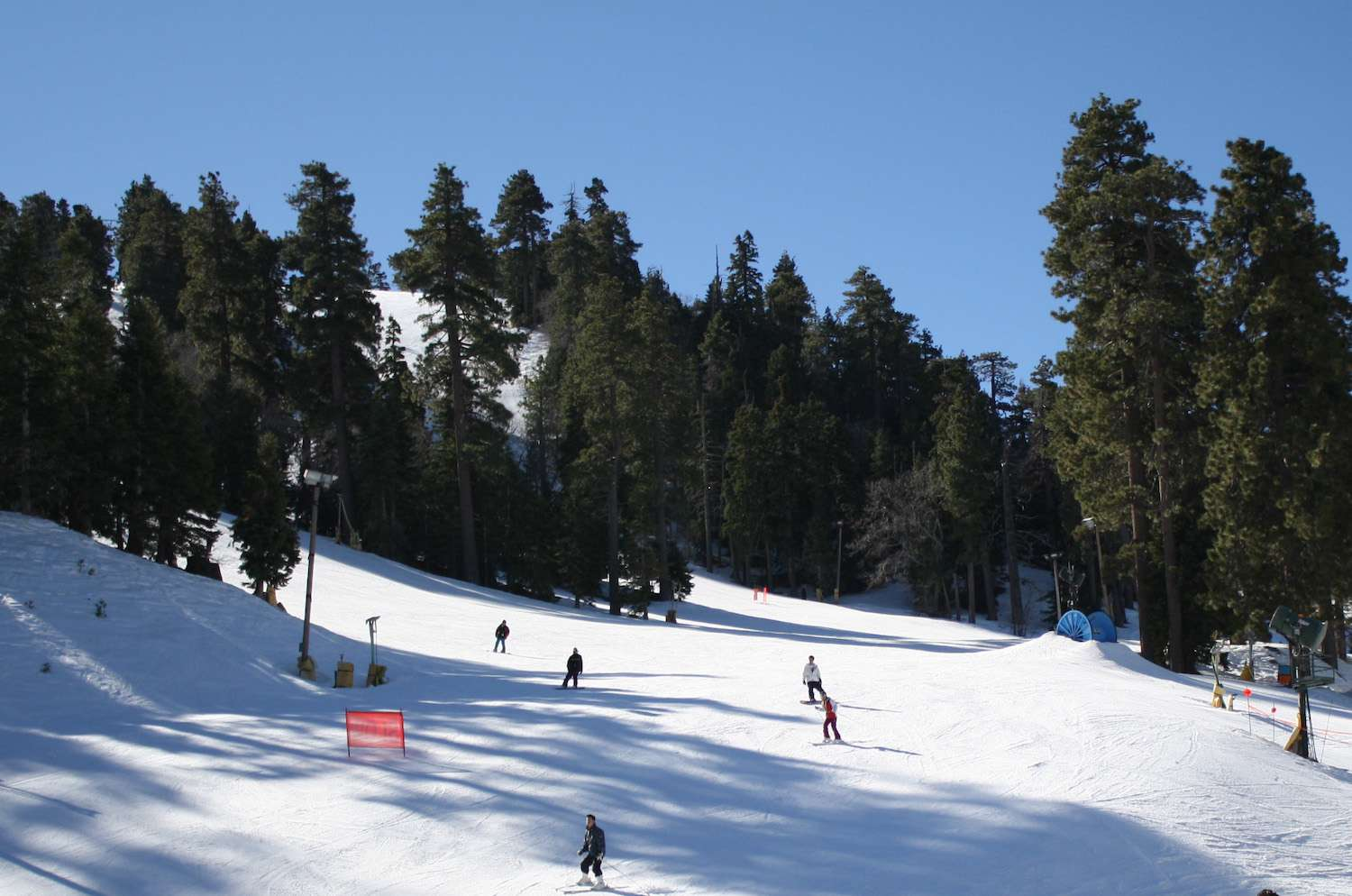 Skiers take to the evergreen-lined slopes of Mountain High