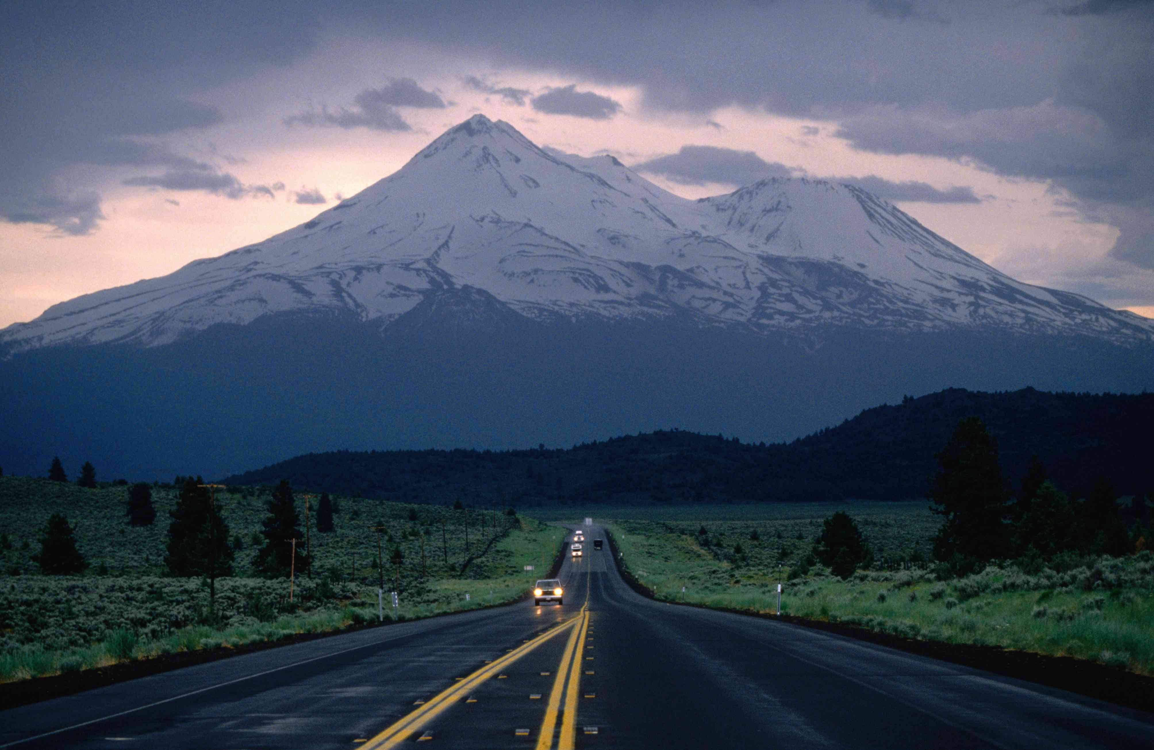 Mt Shasta looming over Highway 97 at dusk