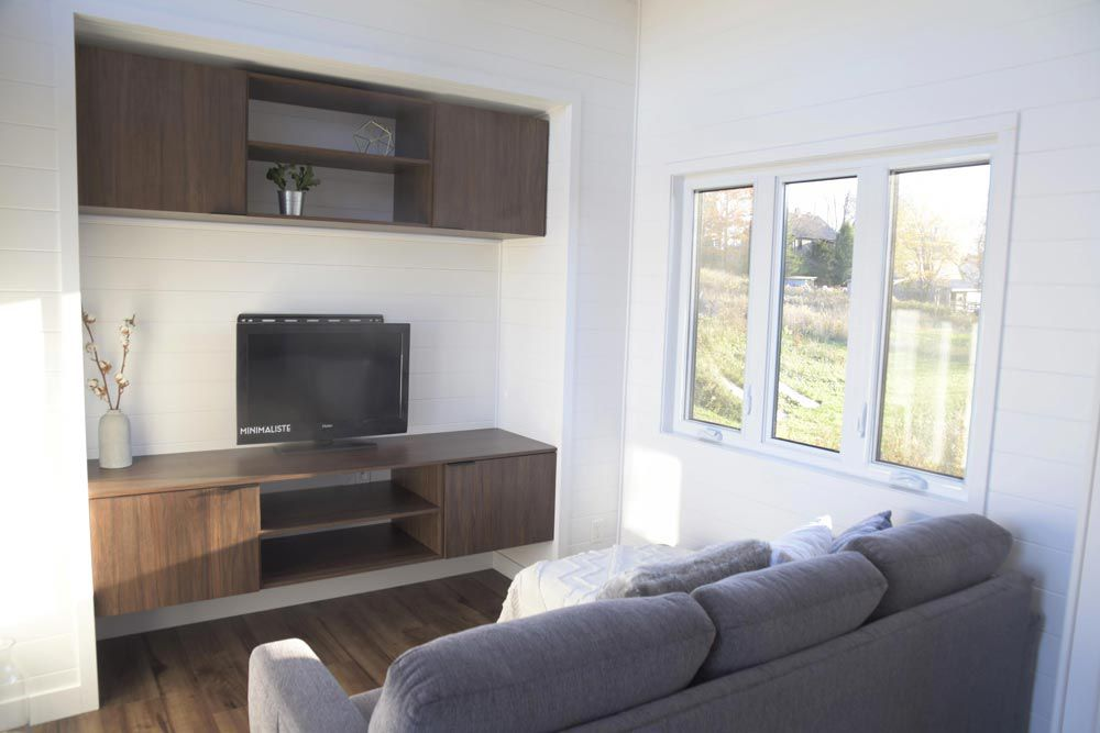 Living room with a sofa and a TV center