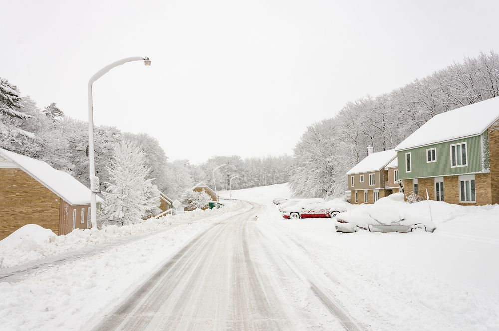 Snow-covered residential street in Michigan's Upper Peninsula