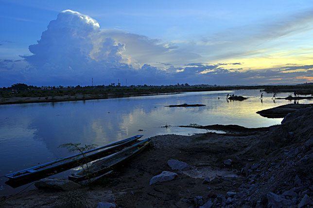 Men bathe in the Mekong River along the shores of Vietntiane, Laos