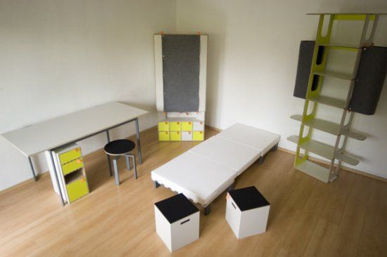 Casulo armoire, a desk, a height-adjustable stool, two more stools, a six-shelf bookcase, and a bed with a mattress.