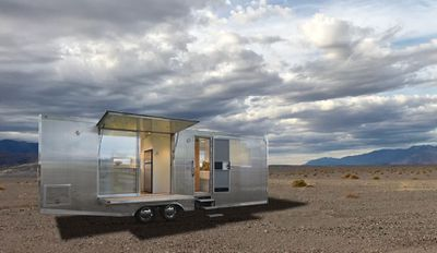Silver exterior of a tiny home parked in the desert
