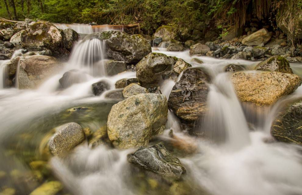 Water flows over rocks in a fast-moving creek