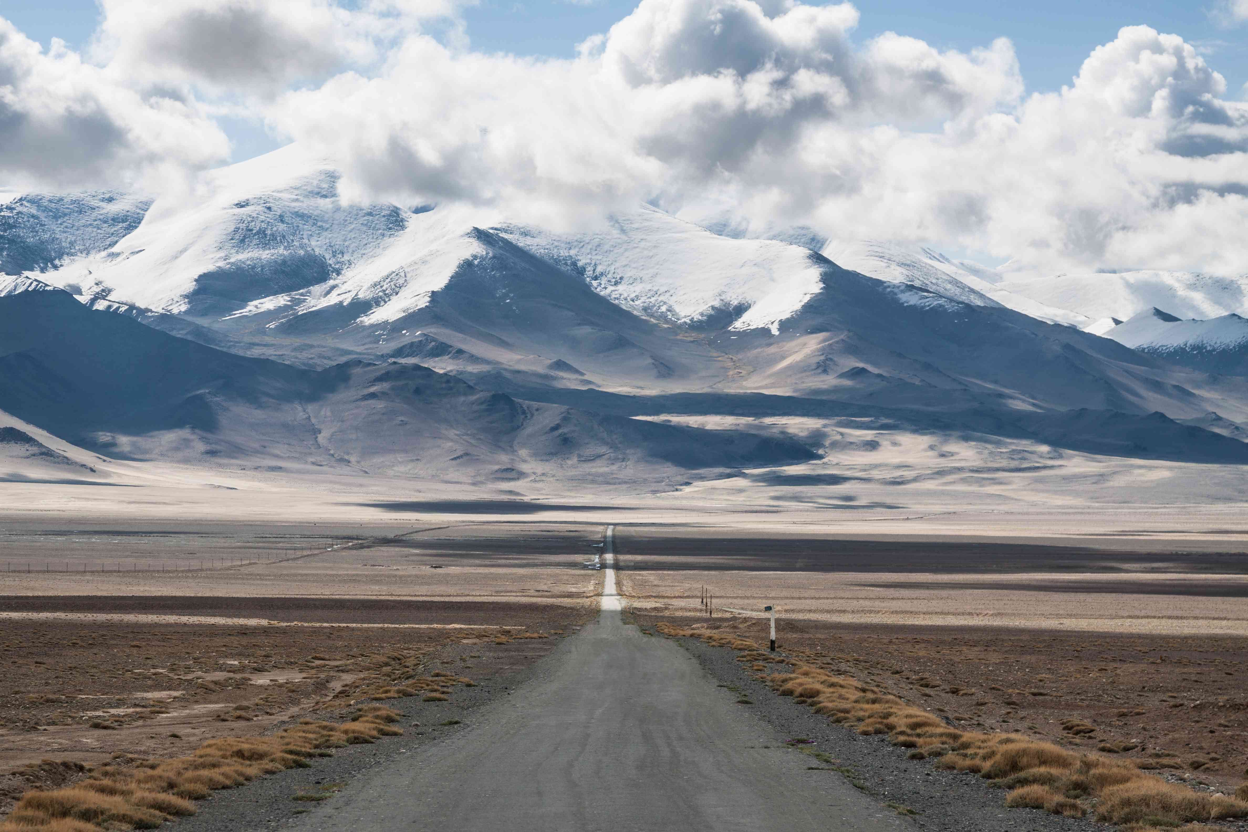 Pamir Highway in Tajikistan with the Pamir Mountains looming in the background