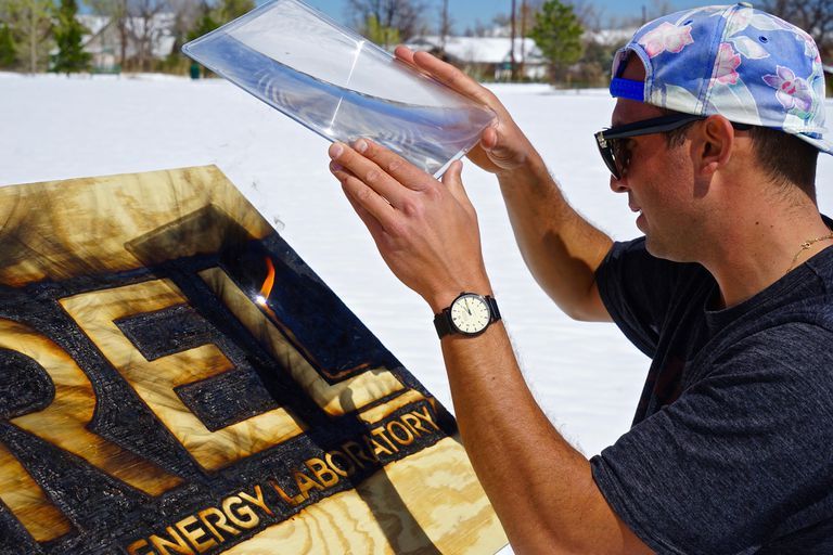Michael Papadakis works on what he calls heliography art.
