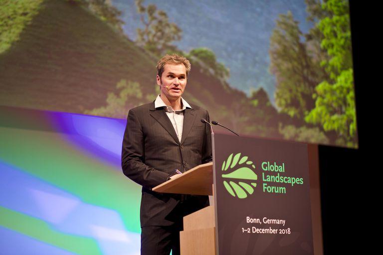 Rhett Butler of Mongabay.com speaking on stage at an event.