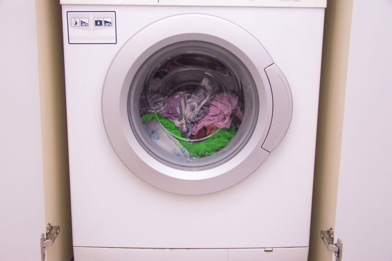 Laundry going through a cycle in a front-load washing machine