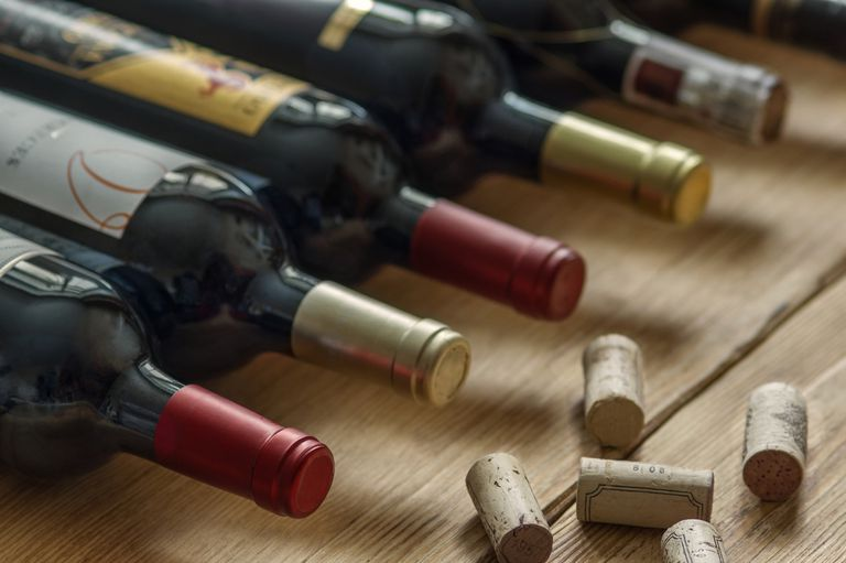 A row of wine bottles and corks