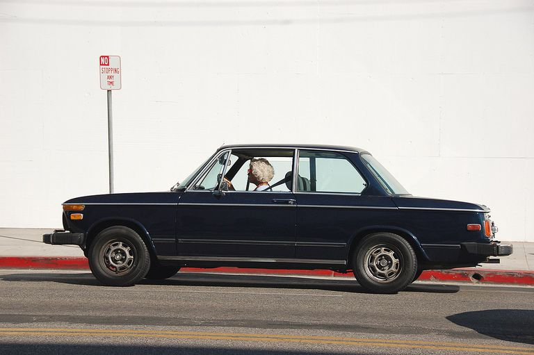 old woman driving old BMW