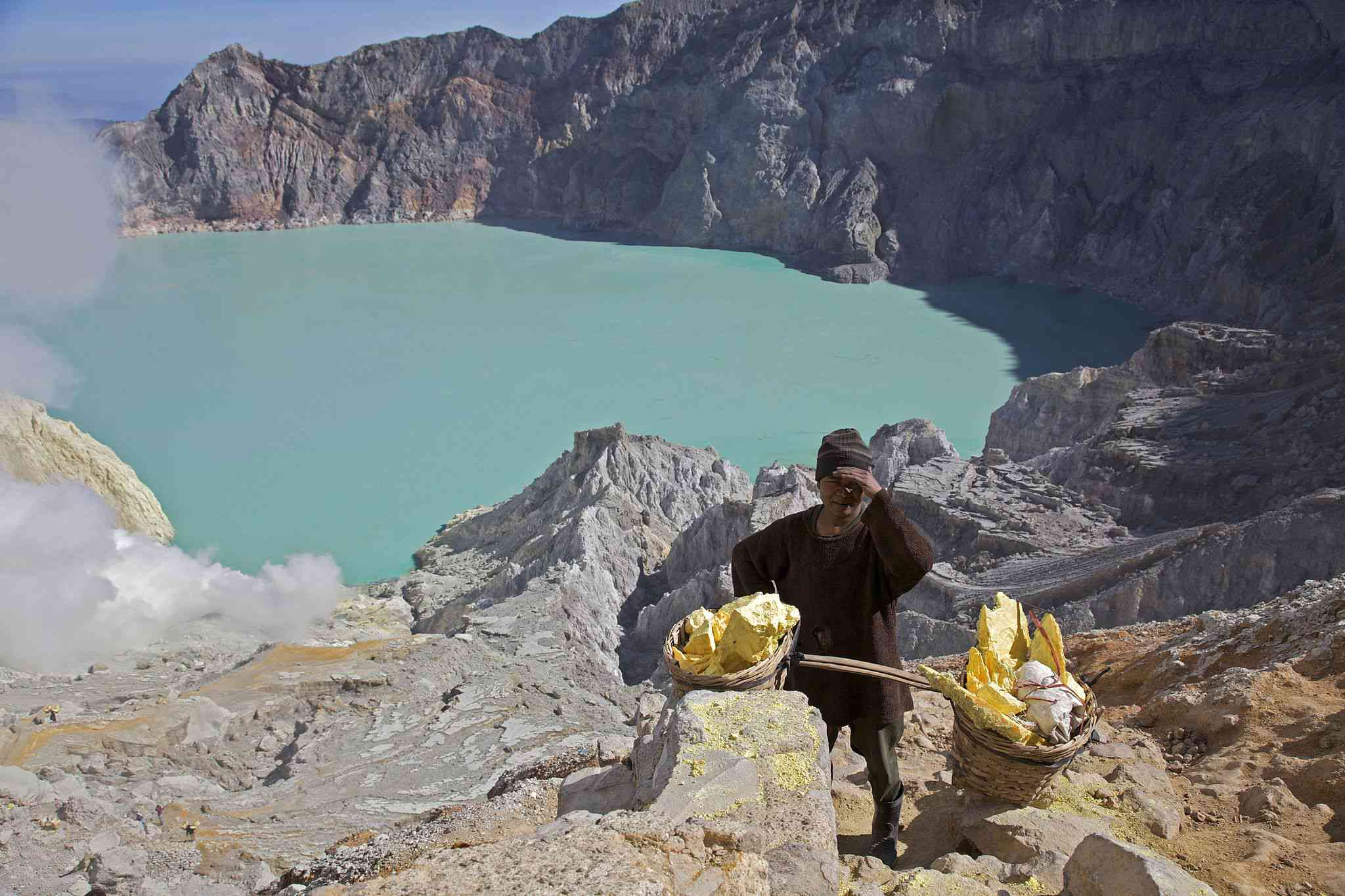 a man mines sulfur in Indonesia