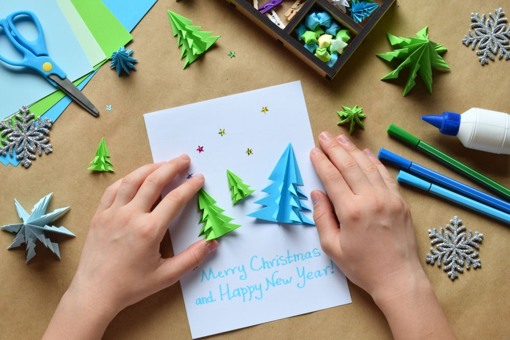 A DIY Christmas card features 3D origami trees