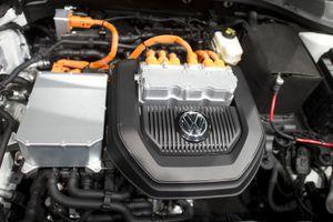 The open hood of an electric Volkswagen e-Golf reveals its motor.