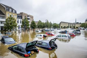 Cars are seen floating in a flooded street on July 15, 2021 in Valkenburg, Netherlands.