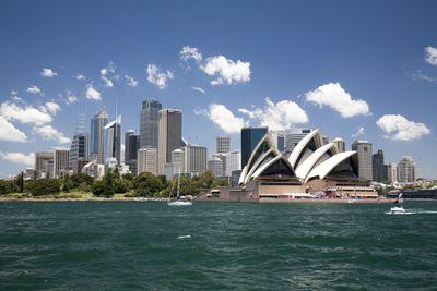 sydney australia skyline, showing sydney opera house and tall buildings on harbor