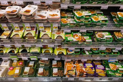 Display with a large collection of vegetarian products and meat alternatives in a supermarket