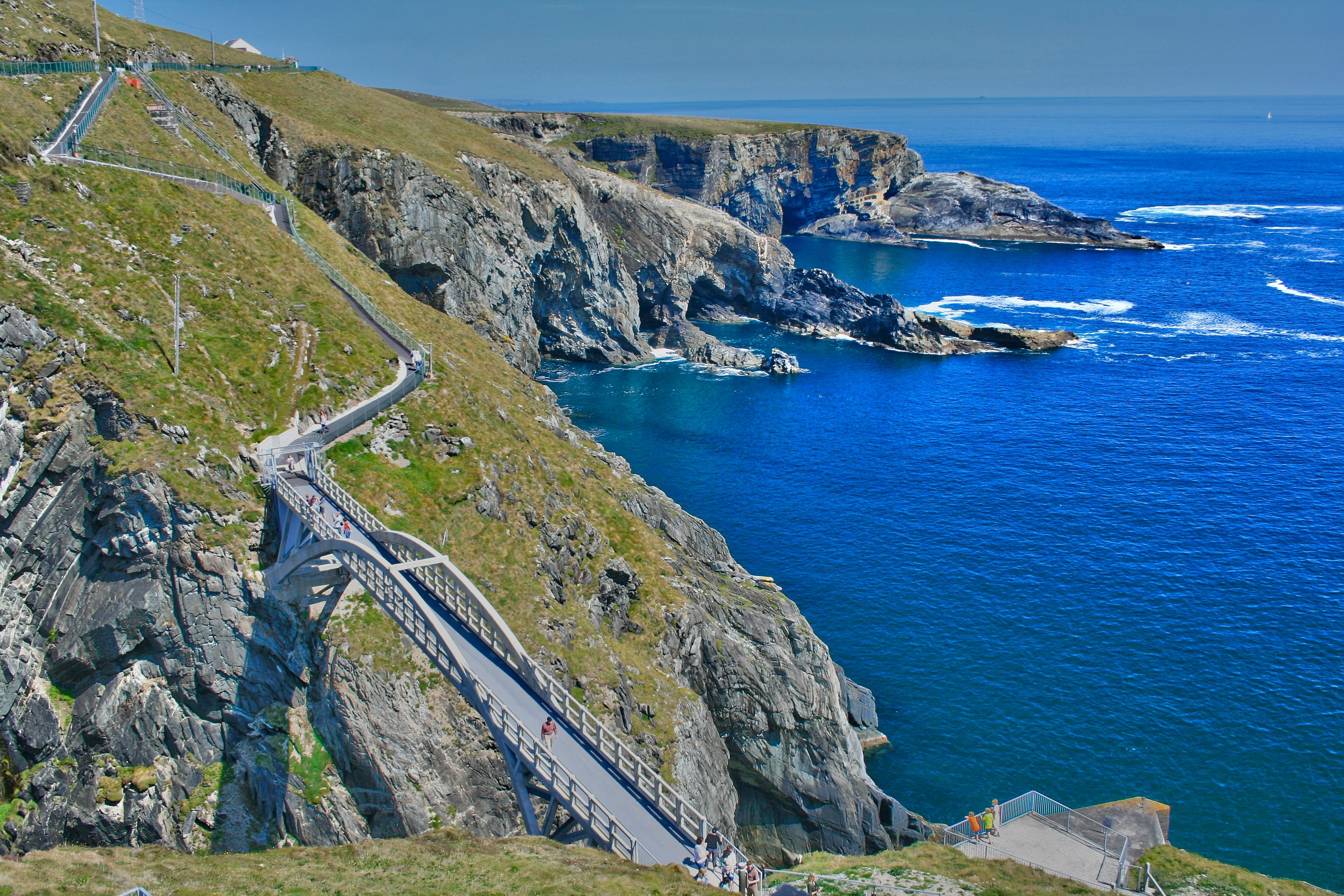 A stunning footbridge connects Mizen Head to a nearby island above deep blue waters
