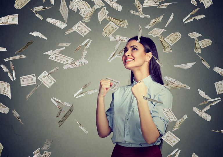 A woman surrounded by falling money