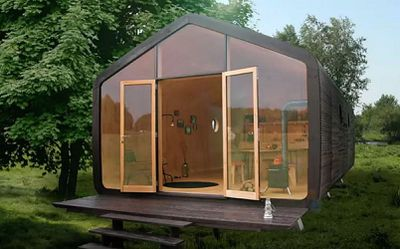 Tiny house with clear panels in front and doors opened