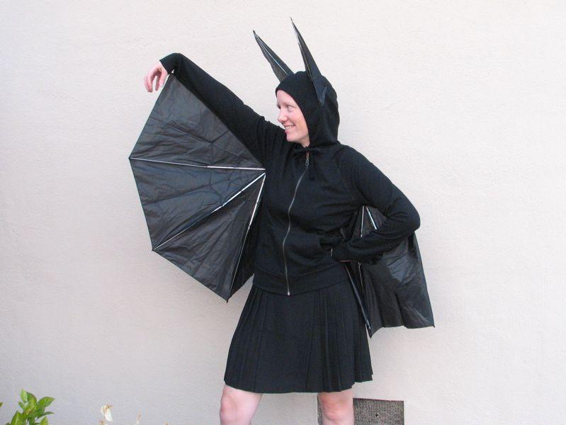 woman wearing bat costume made of umbrellas