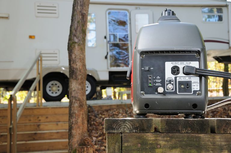 A generator placed in front of an RV van.