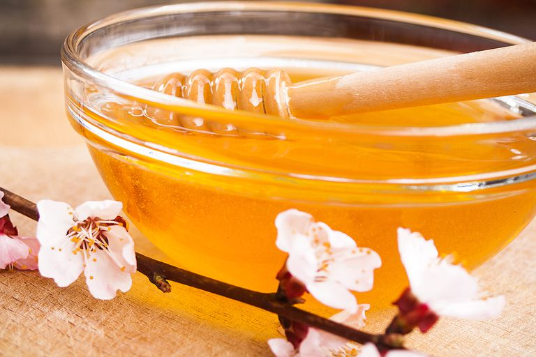 Apricot flowers and Honey in glass bowl