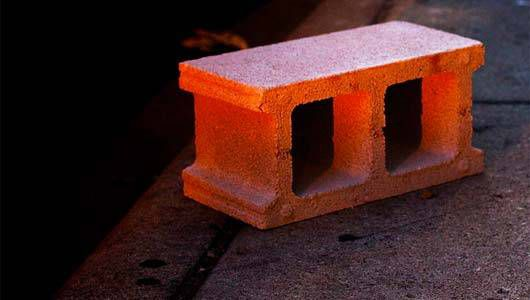 Cinderblock glowing red from nearby light source