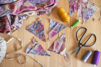 fabric scraps, scissors, and needle and thread for upcycling old fabrics into new projects