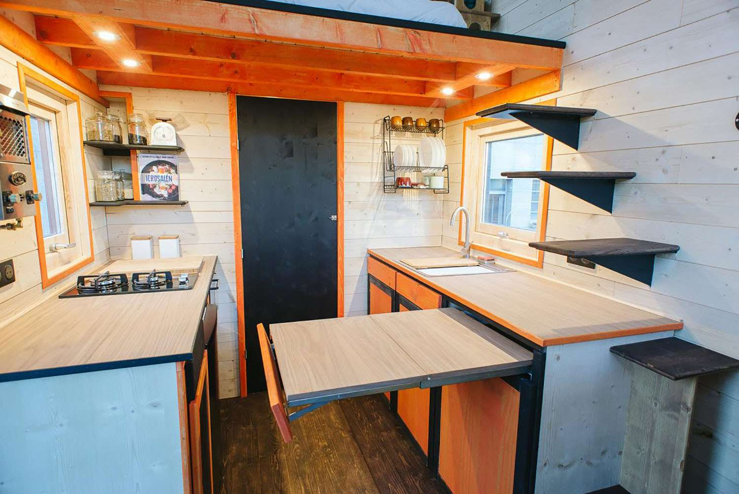 idle tiny house hidden pull out counter