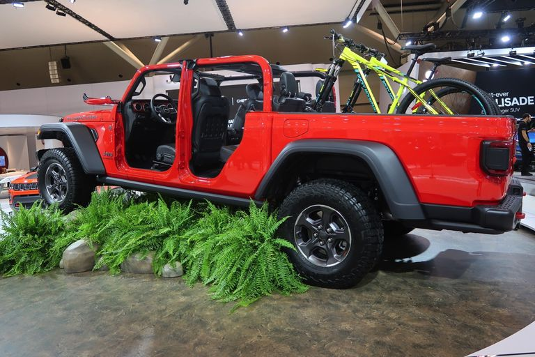 A giant Jeep crushes the verdant landscape