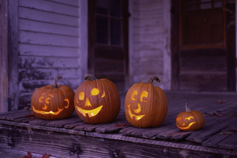 Carved jack-o-lanterns on a stoop