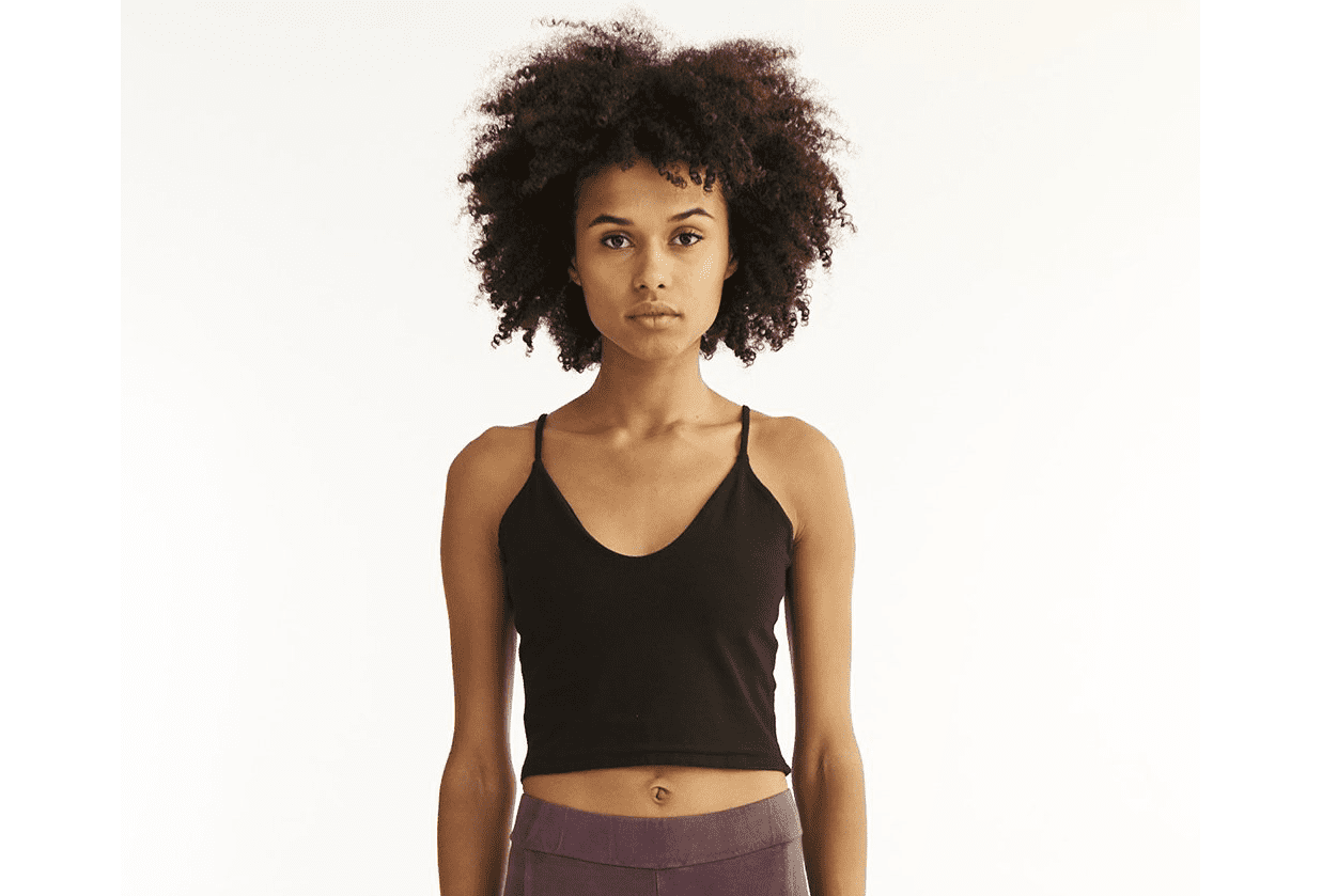 Woman in yoga clothes looking at the camera