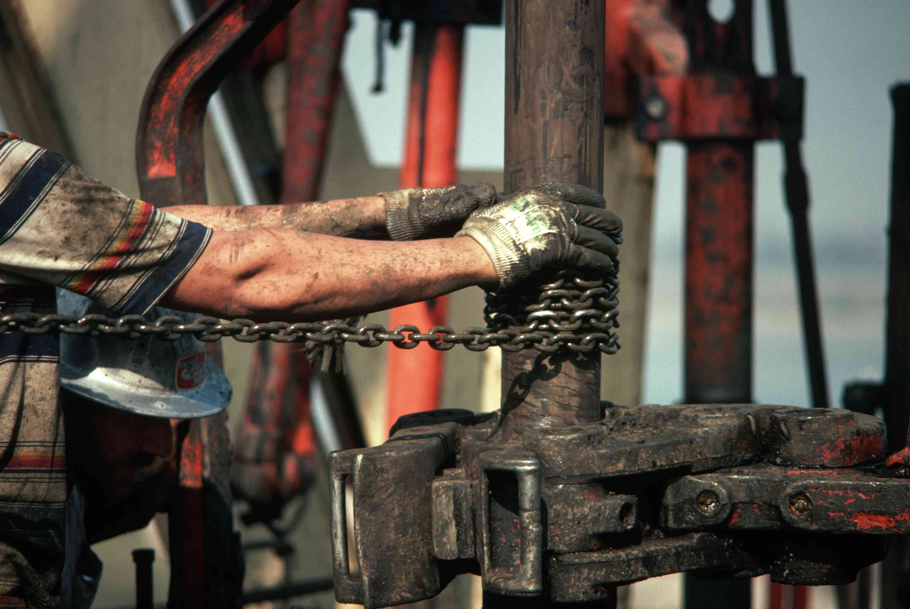 Workers drill an oil well in Southern California