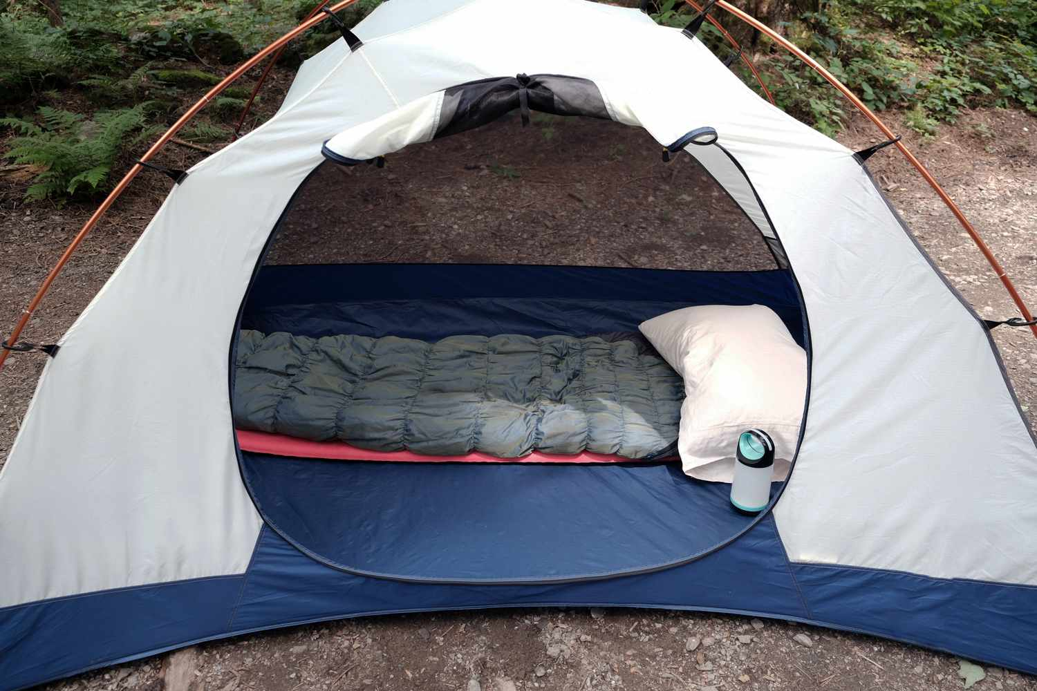 inside of camping tent shows sleeping pad, sleeping bag and pillow