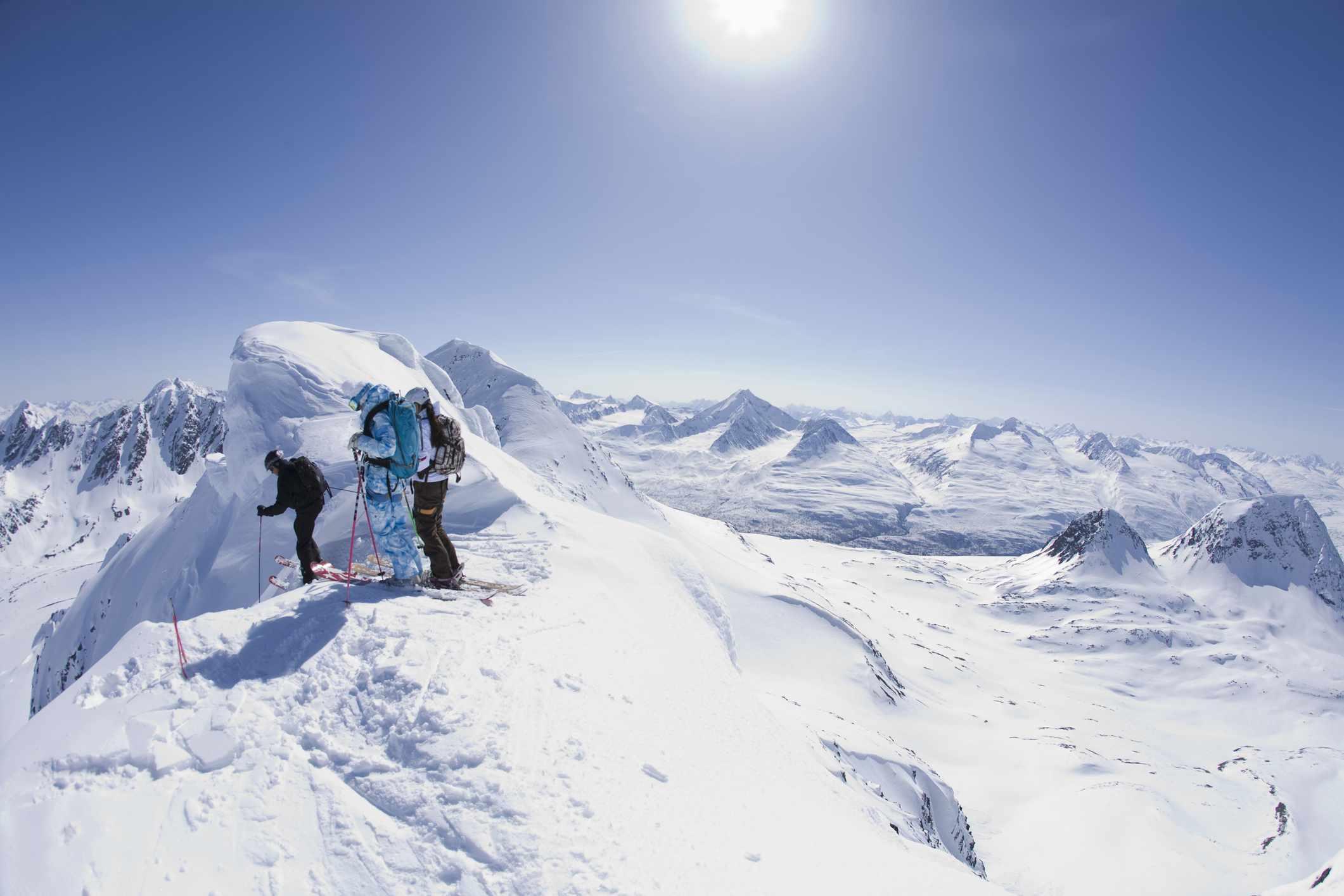 Skiers look down an exposed ridge in Valdez