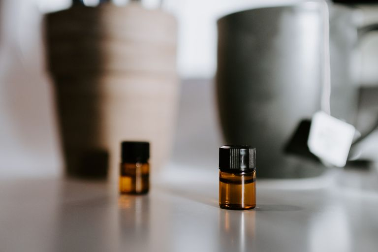 Two bottles of homemade perfume on a countertop