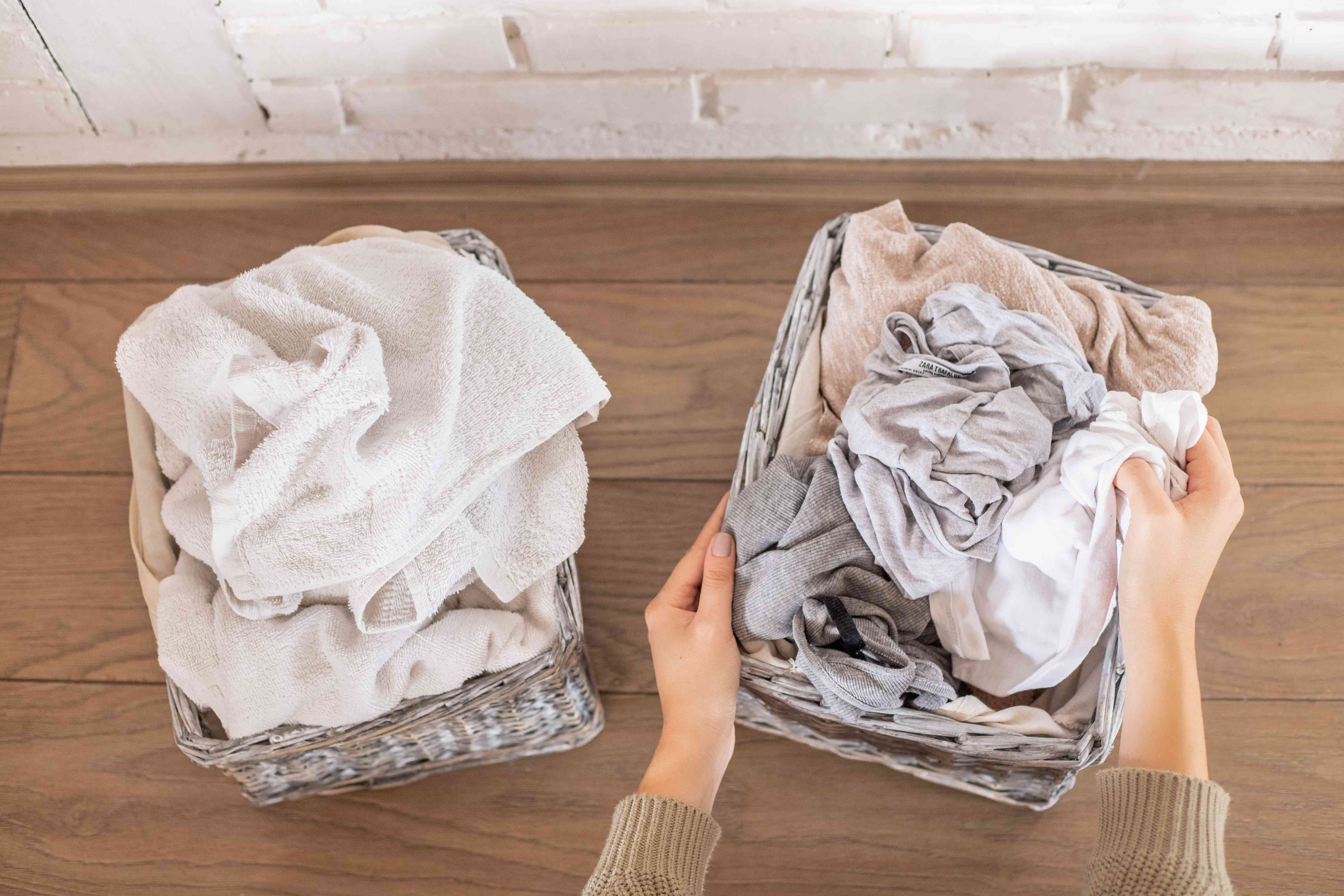 hands separate and fold laundry overhead shot