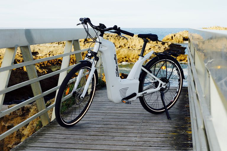 Alpha bike parked on a wooden pedestrian bridge