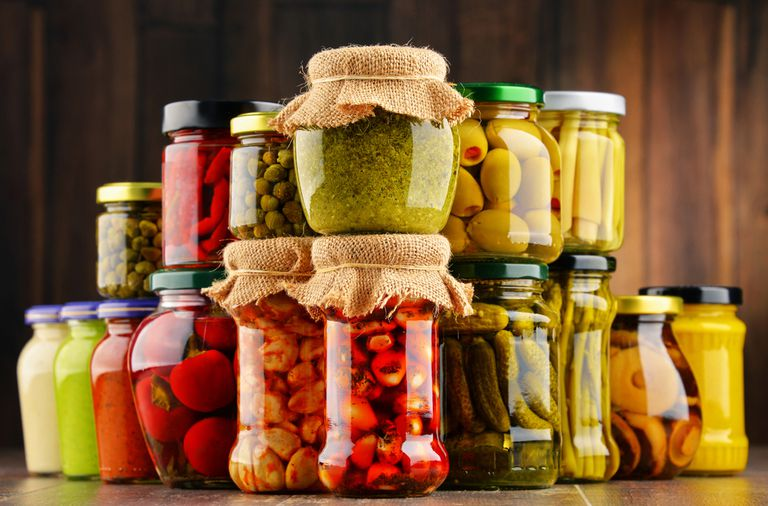 Different foods in jars stacked on top of each other